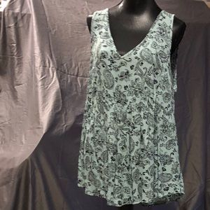 NWT Torrid back-laced floral blouse.